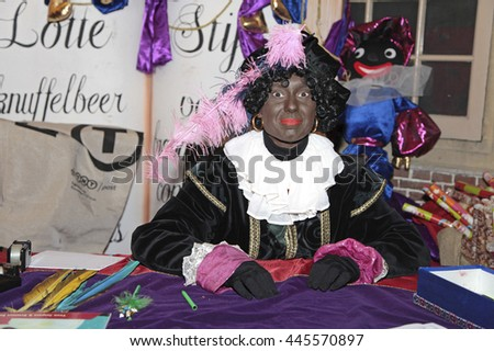 Leiden, The Netherlands - November 2011: Black Pete, a dutch character, in the house of Sinterklaas - stock photo