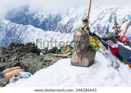 Leinin head statue at the top of Lenin Peak, Pamir Mountains, Kyrgyzstan - stock photo