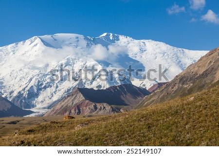 Leinin peak, view from Base camp 1, Pamir mountains, Kyrgyzstan - stock photo