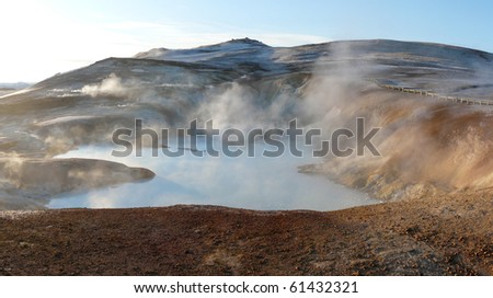 Leirhnjukur, Krafla area, near Lake Myvatn in the north of Iceland. A sulphur containing hot spring surrounded by mudpots, steam vents and fumaroles. - stock photo