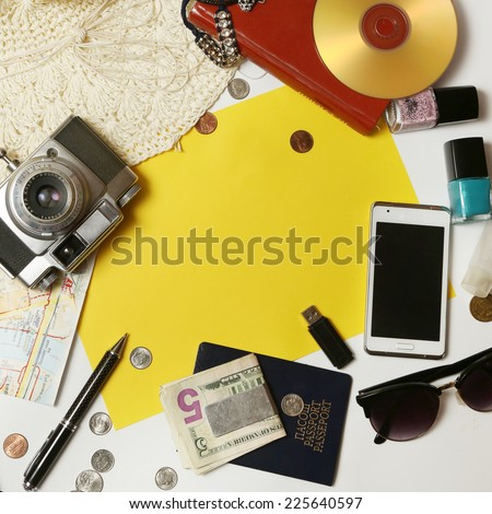 Leisure activity, Yellow paper surrounded with everyday items - planning and organization concept. Add own text.  - stock photo