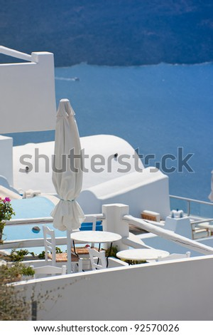 Leisure at a hotel platform of Santorini island,Greece - stock photo
