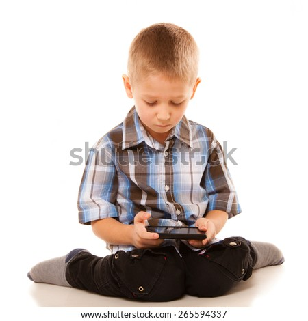 Leisure, technology and internet concept - little boy with smartphone playing games or reading text message - stock photo