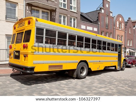 LELYSTAD, THE NETHERLANDS - JUNE 17: A 1995 American school bus on display at the annual National Oldtimer day on June 17, 2012 in Lelystad, The Netherlands - stock photo