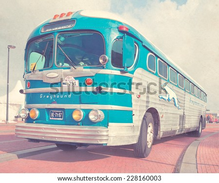 LELYSTAD, THE NETHERLANDS - JUNE 16, 2013: 1948 GM Greyhound Silverside bus is on display at the annual National Oldtimer. Textured filtered image in a nostalgic retro style. - stock photo