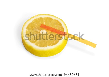 Lemon acid reaction - litmus paper red - stock photo