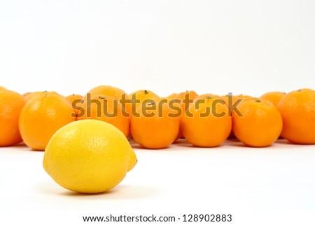 lemon and oranges on a white background symbolizing teamwork, leadership. - stock photo