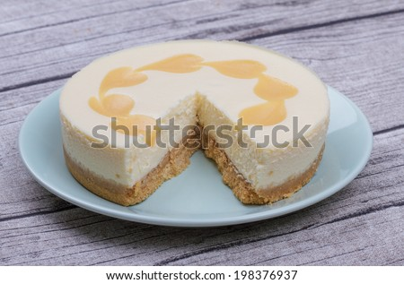Lemon Cheesecake on a Wooden Rustic Table - stock photo