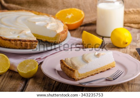 Lemon cheesecake, very simple delicious cake, rustic corners of dough - stock photo