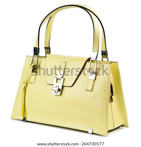 Lemon cream female handbag isolated on white background. - stock photo