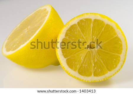 Lemon divided in two partes - stock photo
