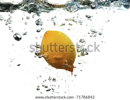 Lemon dropped in a water - stock photo