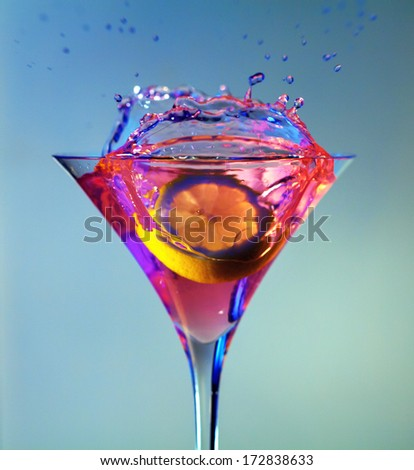 Lemon dropped in the cocktail - stock photo