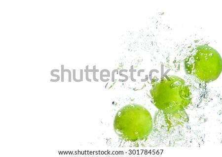 Lemon falling deeply under water - stock photo