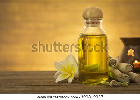 Lemon grass essential oil placed on a wooden table. Space for your text. Spa concept. - stock photo