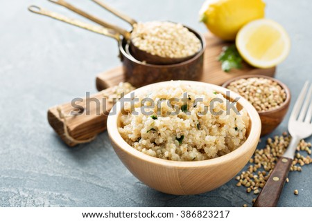 Lemon herbed cooked quinoa in a bowl - stock photo