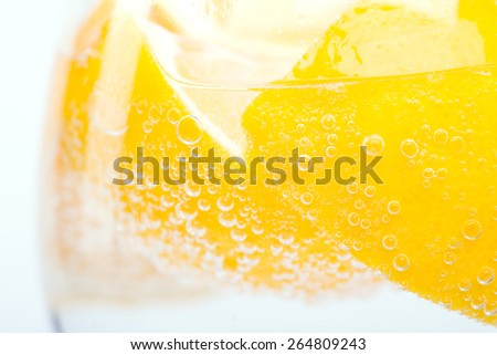 lemon in glass - stock photo