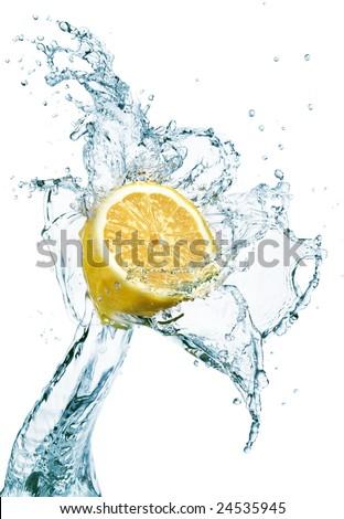 lemon is dropped into water splash - stock photo