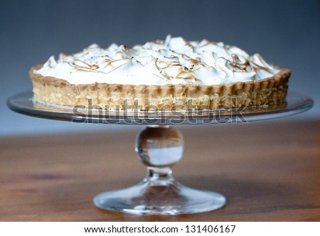 Lemon Meringue Pie on Serving Dish - stock photo
