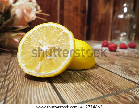 Lemon on the Wooden Table - stock photo