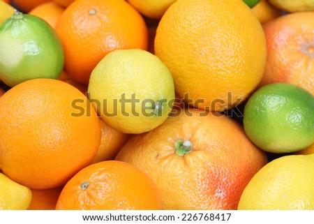 Lemon, orange, lime, tangerine and grapefruit background - stock photo