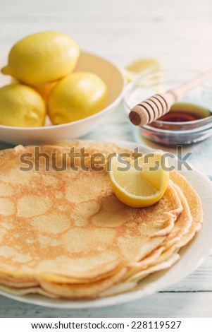 Lemon Pancakes and Bowl of Lemons - stock photo