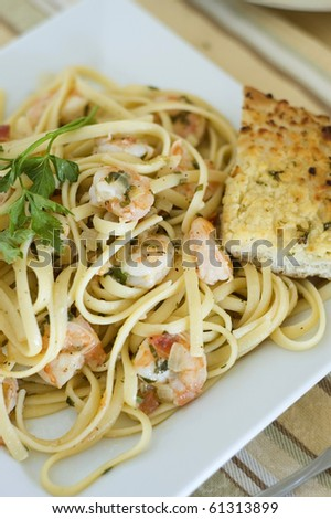 Lemon Pepper Shrimp Linguine Served with Garlic ParmesanToast - stock photo