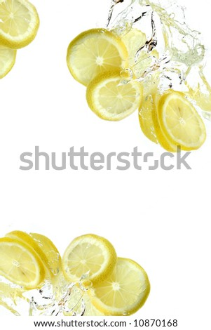 Lemon splashing into water - stock photo