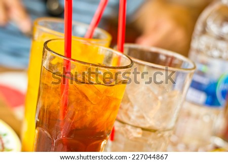 Lemon tea with ice in a glass - stock photo