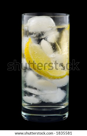 Lemon Wedge in Glass of Cold Mineral Water and Ice. Isolated on Black. - stock photo