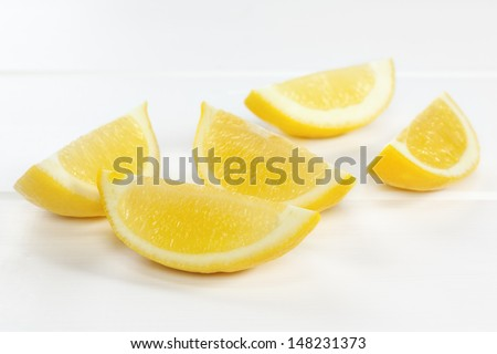 Lemon Wedges on White Background - lemon wedges or slices on a white background with soft shadows. - stock photo