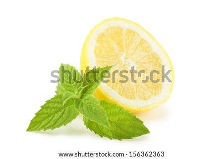 Lemon with mint leaves over white background - stock photo