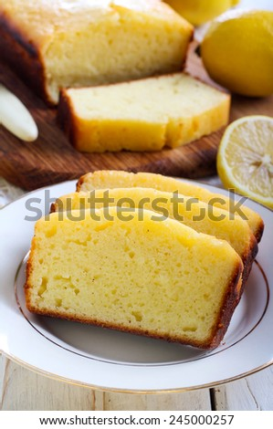 Lemon yogurt loaf cake, sliced on plate - stock photo