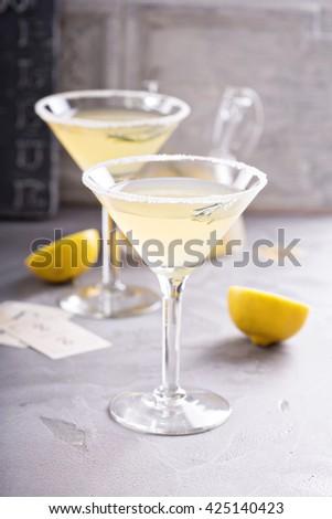 Lemonade martini with rosemary on gray background - stock photo