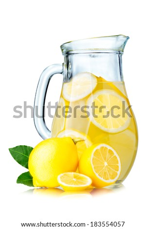 Lemonade pitcher with lemon slices and ice cubes isolated on white - stock photo