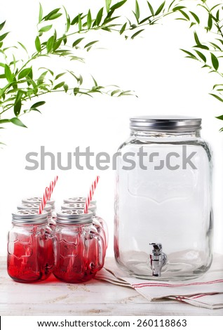 Lemonade, water, beverage dispenser with beverage jars on a white background - stock photo