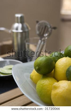 Lemons and Limes on a Bar - stock photo