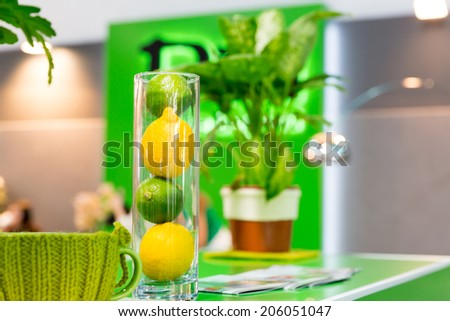 Lemons and other home decorations in glass bowl - stock photo