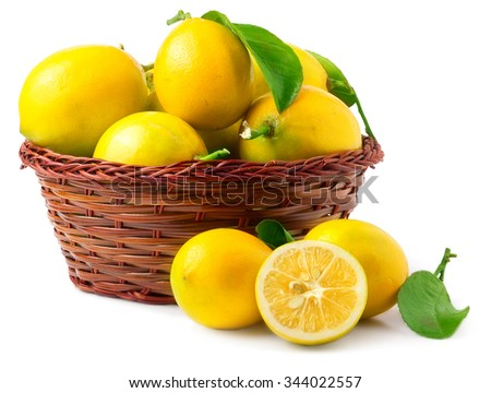 Lemons in basket isolated on white. - stock photo