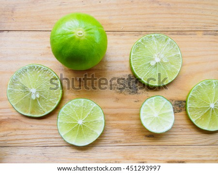 lemons on wooden background. - stock photo