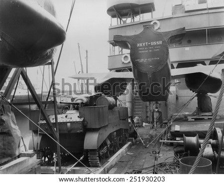 Lend Lease shipment loaded onto a ship bound for the Soviet Union. An airplane is shipped in sections to be joined in the USSR. Ca. 1941-1943. World War 2. - stock photo