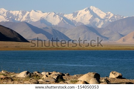 Lenin Peak Pik Lenin behind Karakul Lake, Pamirs, Tajikistan - stock photo