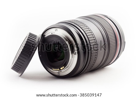 Lens and lens cap - studio recording in front of white background - stock photo