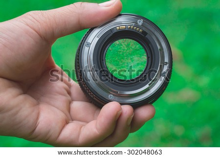 Lens,check,Mobile lenses on a green lawn. - stock photo