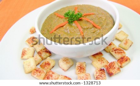Lentil cream soup with bread croutons and carrot - stock photo