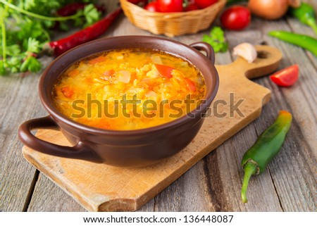 Lentil soup with tomatoes and onion - stock photo