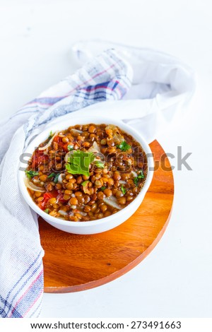 Lentils also known as Dal tempered with spices - stock photo