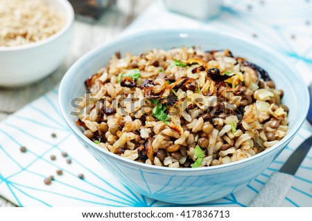 Lentils and rice with Crispy Onions and Parsley. Mujadara. toning. selective focus - stock photo