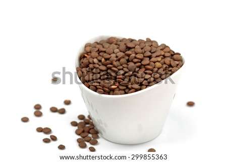 Lentils in a white container. - stock photo