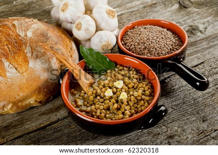 lentils soup with spoon over bowl - stock photo